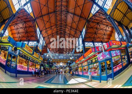 People shopping in the Grand Market Hall. Great Market Hall is the largest indoor market in Budapest, it was built in 1897 in secession style. - Stock Photo