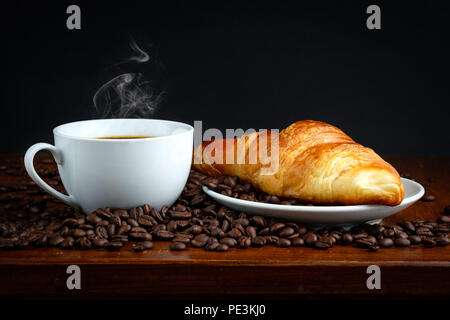 Croissant bread and black coffee - Stock Photo