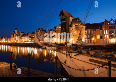 Old Town skyline of Gdansk on tranquil night, old port city at the Motlawa River on Baltic coast in Poland - Stock Photo