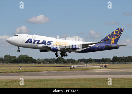 Boeing 747-400F freighter operated by Atlas Air landing at RAF Mildenhall on a military charter. - Stock Photo