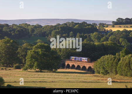 An Arriva Northern rail class 158 express sprinter crossing Melling viaduct on the Settle Junction to Carnforth little north western railway line. - Stock Photo