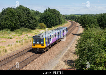 An  Arriva Northern Rail class 142 pacer train at Old Denaby (east of Mexborough, South Yorkshire) - Stock Photo