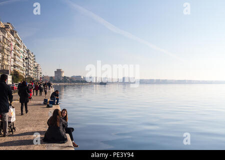 THESSALONIKI, GREECE - DECEMBER 24, 2015: White Tower seen from Thessaloniki seafront (Victory avenue, aka Nikis). The White Tower is one of Thessanol - Stock Photo