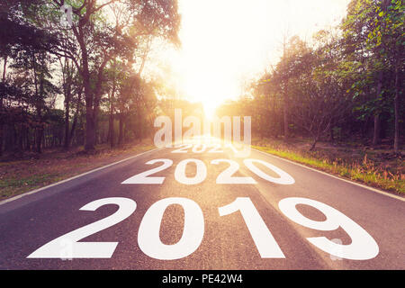 Empty asphalt road and New year 2019 concept. Driving on an empty road to Goals 2019. - Stock Photo