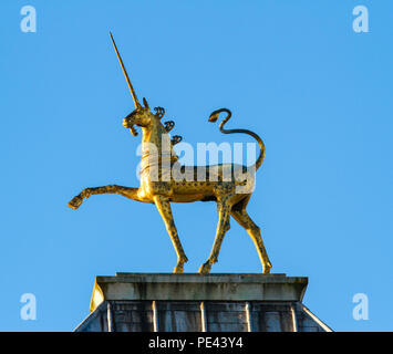 Gilded Unicorn finial - one of a pair of sculptures by David McFall on the roof of City Hall formerly the Council House in Bristol UK - Stock Photo