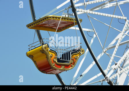Rocking chair of ferry wheel in luna park for children - Stock Photo