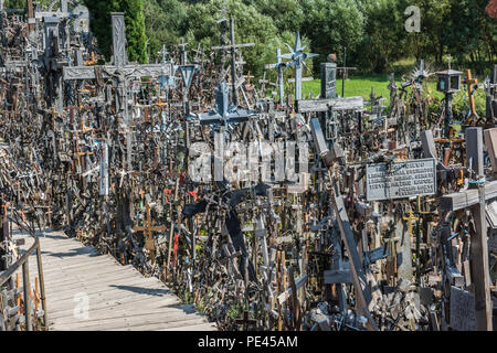 Famous Hill of Crosses a famous site in Lithuania - Stock Photo