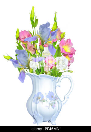 Bouquet of tender pink with yellow Eustoma Lisianthus flowers and blue irises in antique vintage porcelain jug close up, isolated on white background  - Stock Photo