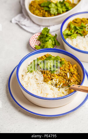 Lentil curry with rice, Indian cuisine, tarka dal, white background. Vegan food. Clean eating concept. - Stock Photo
