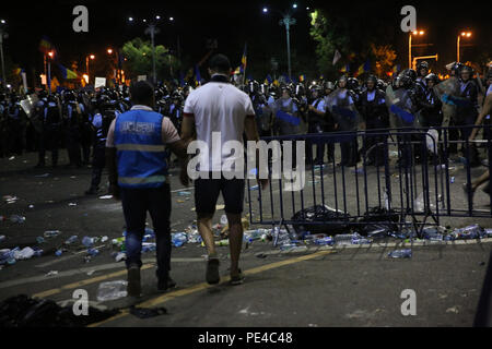 Bucharest, Romania - August 10, 2018: A gendarme is arresting a football supporter during  the violent anti-government protest in Bucharest. - Stock Photo
