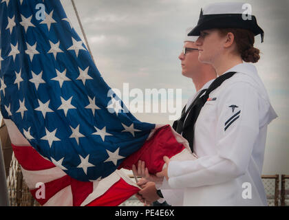 SAN DIEGO (Sept. 11, 2015) - Hospitalman Rachel Standish and Seaman Bobby Pegram assigned to amphibious transport dock ship USS Somerset (LPD 25), prepare to execute colors on the morning of the 14th anniversary in memory of those who lost their lives on Sept. 11, 2001, during the terrorist attacks on U.S. Somerset is the ninth San Antonio-class amphibious transport dock ship and is named in honor of the crew and passengers of United Airlines Flight 93, which crashed near Shanksville, Pa., in Somerset County during the Sept. 11, 2001, terrorist attacks. (U.S. Navy photo by Mass Communication S - Stock Photo