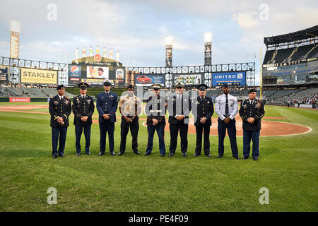 "U.S. service members and first responders pause for a photo prior to the Chicago White Sox ""National Day of Remembrance Take the Field' ceremony, Sept. 11. Service members were at U.S. Cellular Field with first responders to participate in a recognition there during the White Sox home game vs. the Minnesota Twins. (U.S. Army photo by Sgt. 1st Class Anthony L. Taylor/Released) - Stock Photo"