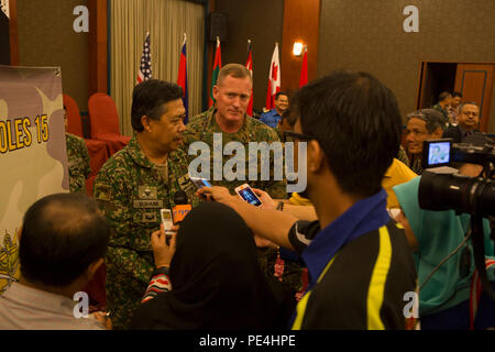 Maj. Gen. Dato' Mohd Suhaimi bin Hj Mohd Zuki, commanding general of the Malaysian Army Training and Doctrine Command, and Brig. Gen. Edward D. Banta, commanding general of Marine Corps Installations West, speak to members of local media, during Non-Lethal Weapons Executive Seminar, Sept. 16, 2015. NOLES is an annual exercise hosted by U.S. Marine Corps Forces, Pacific and is the U.S. Pacific Command's premier multilateral theater security cooperation event for non-lethal weapons. Non-lethal weapons and tactics provide options for U.S. Marines and partner nation militaries while operating in t - Stock Photo