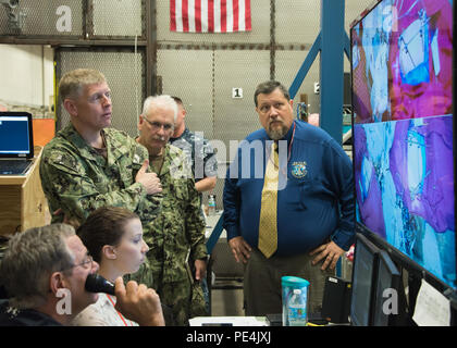 150911-N-CD100-009: Commander, Naval Surface Warfare Center Headquarters Rear Adm. Lorin Selby, U.S. Navy, receives a briefing from the Naval Surface Warfare Center Panama City Division Human Systems Integration team Sept. 11, 2015, regarding an ongoing human factors study. The study seeks to determine the feasibility of specific types of surgeries in high sea states on alternative platforms. (Photo by Anthony Powers, NSWC PCD) - Stock Photo