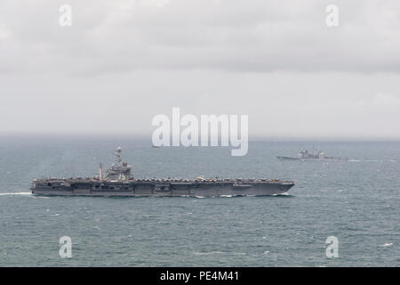 150918-N-ZG705-045 ATLANTIC OCEAN (Sept. 18, 2015) Aircraft carrier USS Harry S. Truman CVN 75 and guided-missile cruiser USS Vicksburg (CG 69) transit the Atlantic Ocean. The Harry S. Truman Carrier Strike Group is underway participating in a Composite Training Unit Exercise (COMPTUEX) in preparation for a future deployment. (U.S. Navy photo by Mass Communication Specialist 2nd Class K. H. Anderson/Released) - Stock Photo