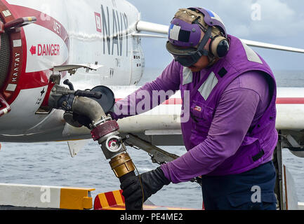 150918-N-KK394-187  ATLANTIC OCEAN (Sept. 18, 2015) - Aviation Boatswain's Mate (Fuel) Airman Charles Wood refuels a T-45C Goshawk attached to Training Air Wing (CTW) 1 on the flight deck of the aircraft carrier USS Dwight D. Eisenhower. Dwight D. Eisenhower is underway conducting carrier qualifications. (U.S. Navy photo by Mass Communication Specialist Seaman Anderson W. Branch/Released) - Stock Photo