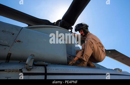 Ogden, Utah, native, 1st Lt. Daniel Wilde, a UH-1Y Huey pilot with Marine Light Attack Helicopter Squadron 169 (HMLA-169), Marine Aircraft Group 39, 3rd Marine Aircraft Wing, I Marine Expeditionary Force, conducts pre-flight checks aboard Marine Corps Base Camp Pendleton, Calif., Sept. 17, 2015. Wilde flew the Huey during weapons proficiency training designed to help new pilots become more comfortable employing the different weapons systems on the aircraft. (U.S. Marine Corps photo by Lance Cpl. Caitlin Bevel) Stock Photo