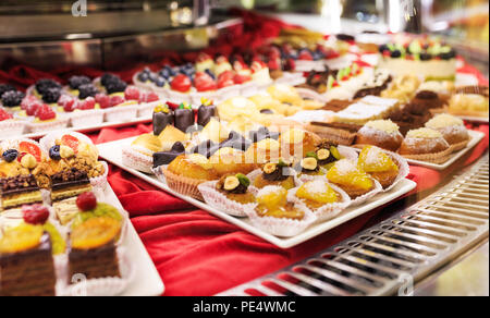 Tasty beautiful cakes on a show-window in cafe. - Stock Photo