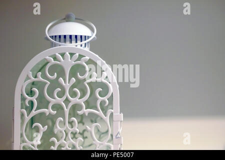 Lamp with carrying ring. A door for placing the candles, white background. - Stock Photo