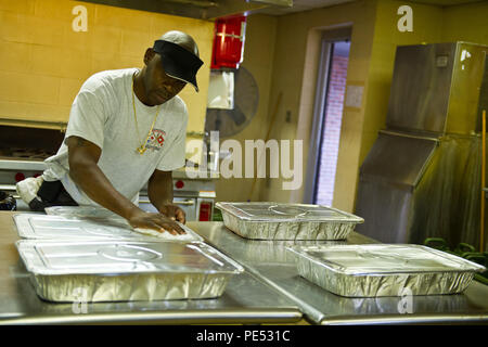 Retired South Carolina Army guardsman Bernard Sherman provides dinner for guardsmen staying at the Georgetown, S.C., armory during the flood response and recovery; the meal was generously donated by a local business, Oct. 9, 2015. The South Carolina National Guard has been activated to support state and county emergency management agencies and local first responders as historic flooding impacts counties statewide. Currently, more than 2,900 South Carolina National Guard members have been activated in response to the floods. (U.S. Air National Guard photo by Tech. Sgt. Jorge Intriago/Released) - Stock Photo
