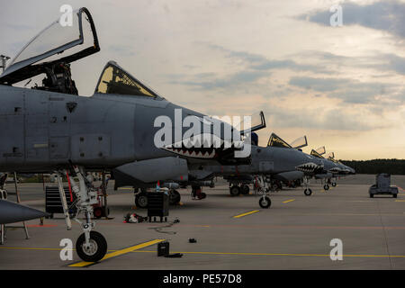 U.S. Air Force A-10 Thunderbolt II attack aircraft assigned to the 74th Expeditionary Fighter Squadron sit on the flightline at Amari Air Base, Estonia, Sept. 21, 2015. Approximately 350 Airmen and support equipment from the 23rd Wing at Moody Air Force Base, Georgia, will conduct routine flying training and participate in several exercises and training events with NATO allies to strengthen interoperability and demonstrate U.S. commitment to the security and stability of Europe. (U.S. Air Force photo by Andrea Jenkins/Released) - Stock Photo