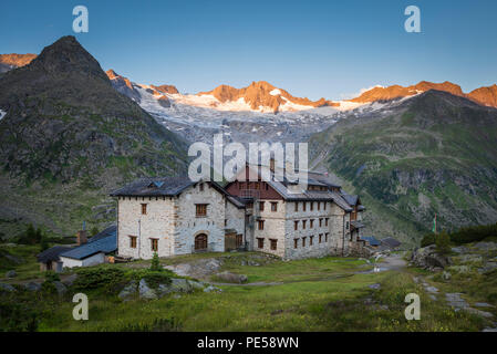 Historic Berlin Hut in the Zillertal with first sunlight on the Waxegkees glacier, Mount Grosser Moeseler and the Schoenbichler Horn, Austria - Stock Photo