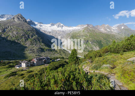 Mountain path leading to historic Berlin Hut in the Zillertal with the Waxegkees glacier, Mount Grosser Moeseler and the Schoenbichler Horn, Austria - Stock Photo