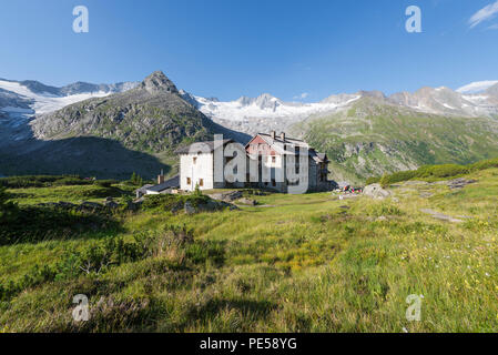 Historic Berlin Hut in the Zillertal with the Waxegkees glacier, Mount Grosser Moeseler and the Schoenbichler Horn, Austria - Stock Photo