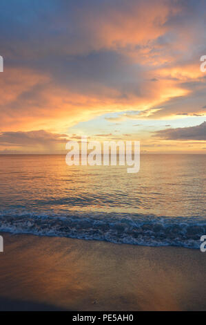 Vertical Photograph of Epic Sunset Over Gulf Of Mexico On Sanibel Island, Florida - Stock Photo