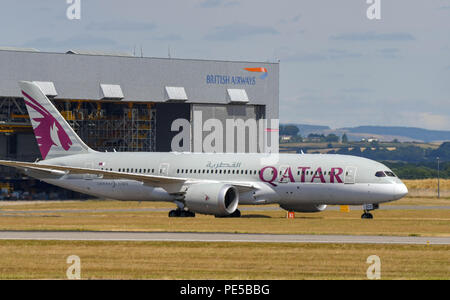 Qatar Airways Boeing 787 Dreamliner taxiing to the Terminal building landing at Cardiff Wales Airport. - Stock Photo