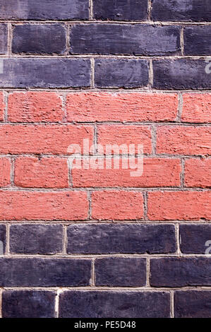 brick wall painted black and orange background. texture, architecture.