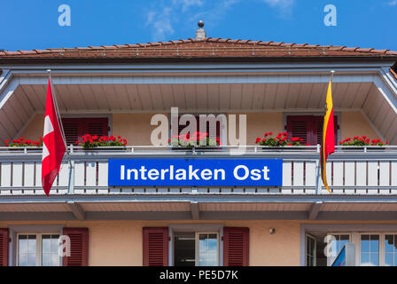 Upper part of the building of the Interlaken Ost railway station in the town of Interlaken - Stock Photo