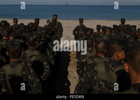 Philippine sailors stand in formation before the simulated beach raid and live fire exercise during Amphibious Landing Exercise 2015 (PHIBLEX 15) at Naval Education and Training Center, Philippines, Oct. 9. PHIBLEX 15 is an annual, bilateral training exercise conducted by U.S. Marines and Navy Forces with the Armed Forces of the Philippines in order to strengthen our interoperability and working relationships across the range of military operations from disaster relief, to complex expeditionary operations. (U.S. Marine Corps photo by Lance Cpl. Robert Gonzales/Released) - Stock Photo