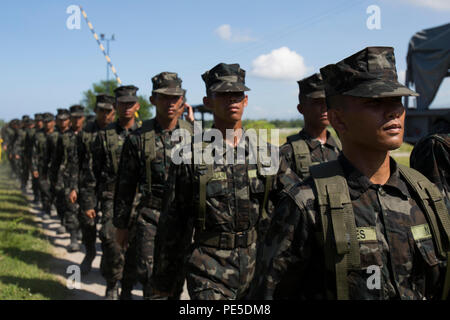 Philippine navy sailors walk in formation during Amphibious Landing Exercise 2015 (PHIBLEX 15) at Naval Education and Training Center, Philippines, Oct. 9. PHIBLEX 15 is an annual, bilateral training exercise conducted by U.S. Marines and Navy Forces with the Armed Forces of the Philippines in order to strengthen our interoperability and working relationships across the range of military operations from disaster relief, to complex expeditionary operations. (U.S. Marine Corps photo by Lance Cpl. Robert Gonzales/Released) - Stock Photo