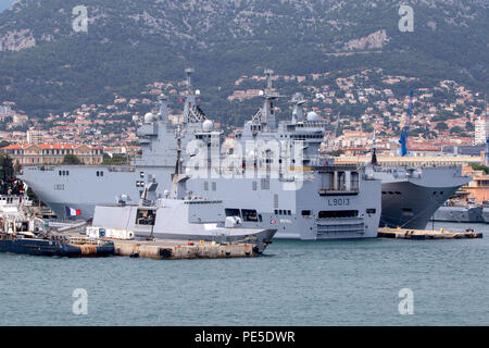 Dixmude L9013 an amphibious assault ship of the French Navy docked at the major French naval base in Toulon in southern France - Stock Photo