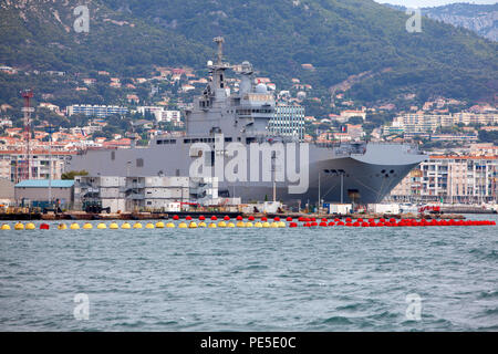 Dixmude L9015 an amphibious assault ship of the French Navy docked at the major French naval base in Toulon in southern France - Stock Photo