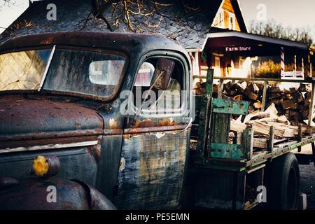 Vintage truck headlight. Rusted aqua sunset. Moody. - Stock Photo