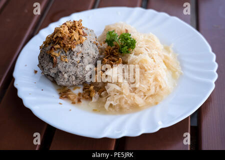Leberknödel mit Suaerkraut (Liver dumpling with Kraut), a typical Palatinate dish - Stock Photo