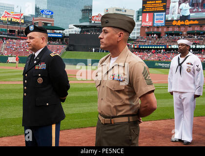150926-N-II118-028 ST. LOUIS (Sept. 26, 2015) – Service members from St. Louis Military Entrance Processing Station (MEPS) wait to take part in a joint oath of enlistment ceremony for Delayed Entry Program participants in recognition of the St. Louis Cardinals annual Military Appreciation Day. Seventy-three MEPS applicants participated in the event. (U.S. Navy photo by Mass Communication Specialist 1st Class Latrice Jackson/Released) - Stock Photo