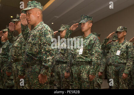 Philippine Marines in formation salute during the opening ceremony for Amphibious Landing Exercise 2015 (PHIBLEX 15) at the Philippine Marine Corps Base in Fort Bonifacio, Taguig City, Philippines, Oct. 1, 2015. PHIBLEX 15 is an annual, bilateral training exercise conducted by U.S. Marine and Navy Forces with the Armed Forces of the Philippines in order to strengthen our interoperability and working relationships across the range of military operations from disaster relief, to complex expeditionary operations. (U.S. Marine Corps photo by Lance Cpl. Juan Bustos/ Released) - Stock Photo