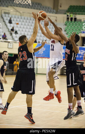 U.S. Men's Basketball Team player Matthew Holland jumps to shoot the ball at the U.S. basketball game against Canada during the 2015 6th CISM World Games. The CISM World Games provides the opportunity for the athletes of over 100 different nations to come together and enjoy friendship through sports. The sixth annual CISM World Games are being held aboard Mungyeong, South Korea, Sept. 30 - Oct. 11. - Stock Photo