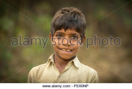 SARUPGANJ, RAJASTHAN, INDIA - JAN 09, 2017 ; An unidentified Indian boy in Village happy to poses for camera, Sarupganj, Rajasthan-India on Jan 09, 20 - Stock Photo