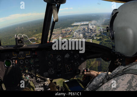 U.S. Army 1st Lt. T.J. Rose, a pilot with the South Carolina Army National Guard's 2-238th General Support Aviation Battalion Detachment 1, flies a Boeing CH-47 Chinook helicopter over flood damaged South Carolina during a statewide flood response, Oct. 6, 2015. The South Carolina National Guard has been activated to support state and county emergency management agencies and local first responders as historic flooding impacts counties statewide. Currently, more than 2,200 South Carolina National Guard members have been activated in response to the floods. (U.S. Air National Guard photo by Airm - Stock Photo