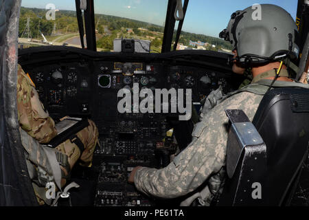 U.S. Army 1st Lt. T.J. Rose, a pilot with the South Carolina Army National Guard's 2-238th General Support Aviation Battalion Detachment 1, maneuvers his Boeing CH-47 Chinook helicopter to assist in moving sandbags to a canal breech in Columbia, S.C., during a statewide flood response, Oct. 7, 2015. The South Carolina National Guard has been activated to support state and county emergency management agencies and local first responders as historic flooding impacts counties statewide. Currently, more than 2,600 South Carolina National Guard members have been activated in response to the floods.  - Stock Photo