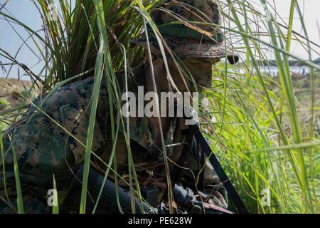U.S. Marine Corps Cpl. Ryan W. Grim radio operator with 3rd Reconnaissance Battalion, currently attached to 3rd Marine Expeditionary Brigade, moves to consolidate with the assaulting element during an amphibious raid at Ternate, Philippines, as a part of Amphibious Landing Exercise 2015 (PHIBLEX 15), Oct. 8. PHIBLEX 15 is an annual bilateral training exercise conducted with the Armed Forces of the Philippines in order to strengthen our interoperability and working relationships across a wide range of military operations from disaster relief to complex expeditionary operations. (U.S. Marine Cor