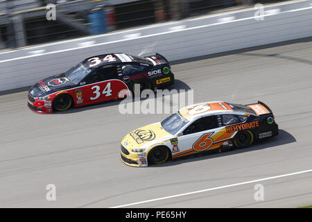 Brooklyn, Michigan, USA. 12th Aug, 2018. Trevor Bayne (6) and Michael McDowell (34) battle for position during the Consumers Energy 400 at Michigan International Speedway in Brooklyn, Michigan. Credit: Chris Owens Asp Inc/ASP/ZUMA Wire/Alamy Live News - Stock Photo