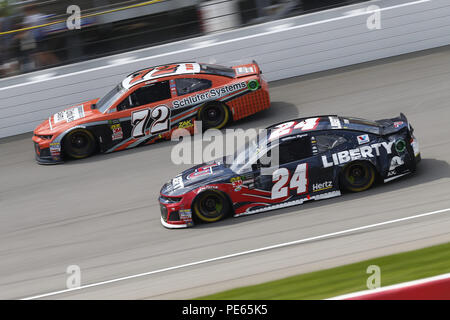 Brooklyn, Michigan, USA. 12th Aug, 2018. William Byron (24) and Corey LaJoie (72) battle for position during the Consumers Energy 400 at Michigan International Speedway in Brooklyn, Michigan. Credit: Chris Owens Asp Inc/ASP/ZUMA Wire/Alamy Live News - Stock Photo