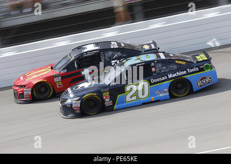 Brooklyn, Michigan, USA. 12th Aug, 2018. Jamie McMurray (1) and Erik Jones (20) battle for position during the Consumers Energy 400 at Michigan International Speedway in Brooklyn, Michigan. Credit: Chris Owens Asp Inc/ASP/ZUMA Wire/Alamy Live News - Stock Photo
