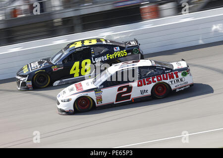 Brooklyn, Michigan, USA. 12th Aug, 2018. Jimmie Johnson (48) and Brad Keselowski (2) battle for position during the Consumers Energy 400 at Michigan International Speedway in Brooklyn, Michigan. Credit: Chris Owens Asp Inc/ASP/ZUMA Wire/Alamy Live News - Stock Photo