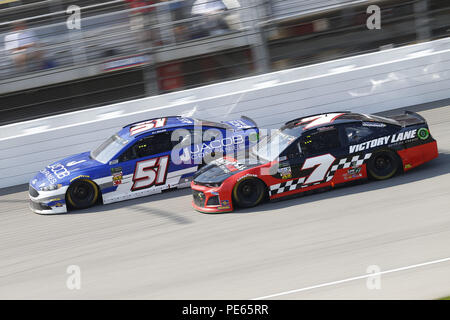 Brooklyn, Michigan, USA. 12th Aug, 2018. BJ McLeod (51) and Garrett Smithley (7) battle for position during the Consumers Energy 400 at Michigan International Speedway in Brooklyn, Michigan. Credit: Chris Owens Asp Inc/ASP/ZUMA Wire/Alamy Live News - Stock Photo